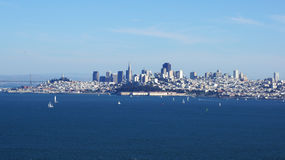 SAN FRANCISCO, USA - OCTOBER 4th, 2014: View of downtown skyscraper cityscape with little sail boots ships royalty free stock images