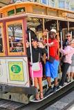 San Francisco Waving Cable Car Passengers Fotografia de Stock Royalty Free
