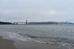 Golden Gate Bridge sandwiched between fog and sea, 1. royalty free stock photos