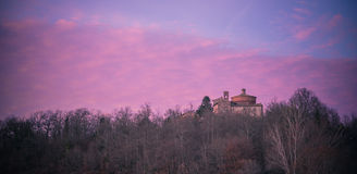 San Galgano Chapel, Tuscany. View of medieval San Galgano Chapel on the hill of Montesiepi at the sunset. The chapel preserves the sword in the stone that San Stock Image