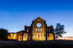 San Galgano roofless Cistercian abbey in Tuscany at sunset. Royalty Free Stock Image