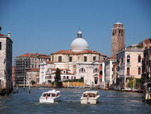 San Geremia is a church in Venice. VENICE, ITALY - JULY 03: Tourist and locals enjoy sighting all the landmarks in Venice while traveling along the canal on the Royalty Free Stock Photos