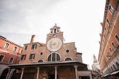 San Giacomo di Rialto Church with Ancient Buildings Made from Re Stock Photography