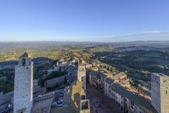 San Gimignano, Сиена, Тоскана, Италия, взгляд от большой башни Стоковые Фото