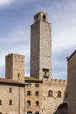 San Gimignano, Chigi tower (on the left side), Tuscany, Italy Stock Image