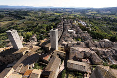 San Gimignano, Italy. The view from the top of the tallest tower in San Gimignano Italy, looks out over this historic, walled Tuscan hill town and out over the stock photos