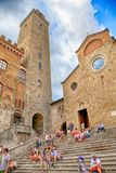 Tourists in Piazza del Duomo at medieval town of San Gimignano, Royalty Free Stock Photos