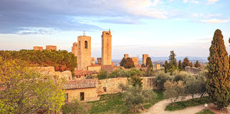 San Gimignano landmark medieval town on sunset, towers and park. Royalty Free Stock Image