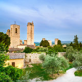 San Gimignano landmark medieval town on sunset, towers and park. Tuscany, Italy Stock Photo