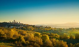 San Gimignano medieval town towers skyline and landscape. Tuscan. San Gimignano medieval town towers skyline and countryside landscape panorama at sunrise Royalty Free Stock Photography