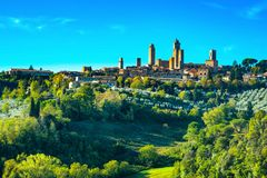 San Gimignano medieval town towers skyline and landscape. Tuscan. San Gimignano medieval town towers skyline and countryside landscape panorama on sunset Stock Photo
