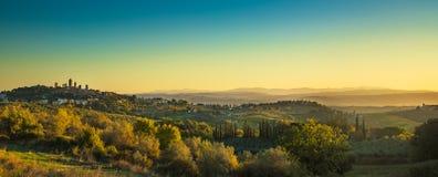 San Gimignano medieval town towers skyline and landscape. Tuscan. San Gimignano medieval town towers skyline and countryside landscape panorama at sunrise Stock Photography