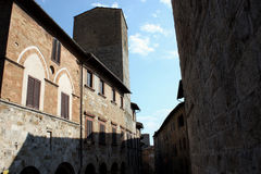 San Gimignano n.10. Some old buildings walking in a street in famous San Gimignano, old village site in the list of Unesco World Heritage for his beautiful Royalty Free Stock Images