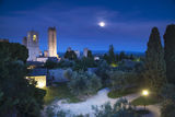 San Gimignano night, medieval town landmark in moon light, tower Stock Images