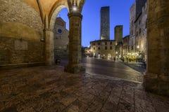 San Gimignano, Siena, Toscana, Italia, Europa, il quadrato della cattedrale Immagini Stock