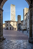 San Gimignano, Siena, Toscana, Italia, Europa, il quadrato della cattedrale Immagini Stock Libere da Diritti