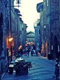 San gimignano street in the evening. Old medieval street of san gimignano in tuscany, italy in the evening Royalty Free Stock Photo