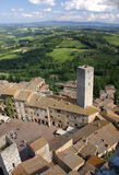 San Gimignano and Tuscan landscape. Towers and houses at the central square of San Gimignano, a historic city in Tuscany, Italy Stock Photos
