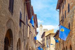 The medieval architectures of San Giminiano. San Giminiano, Italy, the medieval architectures of St. Giovanni street Royalty Free Stock Photos