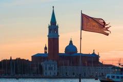 San Giorgio di Maggiore church flag of Venice in the foreground Stock Images