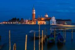 San Giorgio Maggiore. At night as seen from San Marco square in Venice, Italy Stock Photos