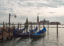 San Giorgio Maggiore church and gondolas in Venice on sunset Stock Images