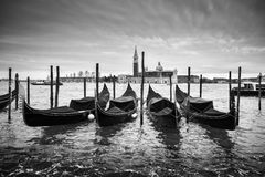 San Giorgio Maggiore church with moored gondolas bw Royalty Free Stock Images