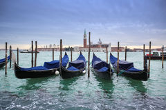 San Giorgio Maggiore church with moored gondolas Stock Photos
