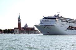 San Giorgio Maggiore island and cruiser, Venice. A cruiser is leaving Venice by the Canale di San Marco between San Giorgio Maggiore and Venice. San Giorgio stock photo