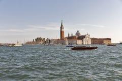 San Giorgio Maggiore island in Venice, Italy. Venice lagoon with vaporetto, taxi and police boats and San Giorgio Maggiore island, Italy stock photo