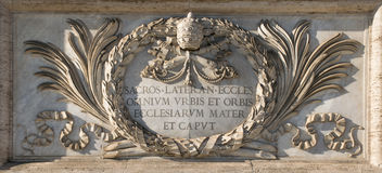 San Giovanni cathedral's plate. Marble plaque on the facade of the cathedral of San Giovanni in Rome Royalty Free Stock Photography
