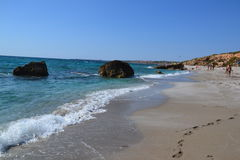 San Giovanni di Sinis beach in Sardinia, Italy. Panoramic view of the sandy beach of a seaside resort San Giovanni di Sinis in Sardinia, Italy Stock Photo