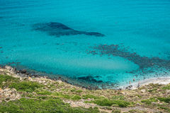 San Giovanni di Sinis coastline on a sunny day in Sardinia. Sinis peninsula, Cabras, Oristano province, Sardinia, Italy. Beautiful blue sky and few people in Stock Images