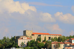 San Giusto's fortress (Castello di San Giusto). Trieste, Italy. The ancient fortress protecting Trieste. San Giusto's towering over the city on the hill of the stock photo