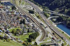 San Gottardo Pass, Switzerland - A view of the village Airolo an. A view of the village Airolo and the Motorway to the San Gotthard Tunnel, the most Stock Image