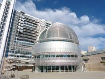 San Jose City Hall. Round metal and glass structure with blue sky and clouds Stock Photos