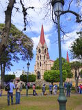 Cathedral and people standing in park Royalty Free Stock Photos