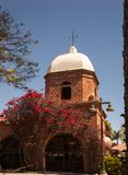 San Juan Capistrano classic design. The typical Old Style Spanish California design of the San Juan Capistrano area is captured here with brick, dome and Stock Photo
