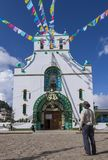 Foreign tourist visiting Church of San Juan Chamula in Chiapas. SAN JUAN CHAMULA, CHIAPAS, MEXICO - JUNE 23, 2018: San Juan Chamula preserves a unique and stock photography