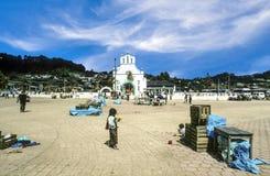 San Juan Chamula in Mexico. CHAMULA, MEXICO - June 10, 1993: Market square and the church of San Juan in San Juan Chamula royalty free stock photography