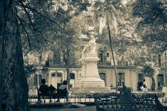 San Juan de Dios park, Havana, Cuba. Havana, Cuba - 2012, November 29 : The park San Juan de Dios in Old Havana with the marble statue of Cervantes in the center Stock Photo