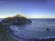 San Juan de Gaztelugatxe. Monastery of San Juan de Gaztelugatxe at sunrise. Dawn breaks and give us that amazing light Royalty Free Stock Photography