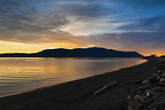 San Juan Islands Sunset. A beautiful panoramic winter sunset from Legoe Bay on Lummi Island looking west towards Orcas Island in the San Juan archipelago in Stock Photography