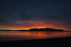 San Juan Islands Sunset. A beautiful panoramic winter sunset from Legoe Bay on Lummi Island looking west towards Orcas Island in the San Juan archipelago in Stock Image