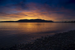 San Juan Islands Sunset. A beautiful panoramic winter sunset from Legoe Bay on Lummi Island looking west towards Orcas Island in the San Juan archipelago in Royalty Free Stock Photo