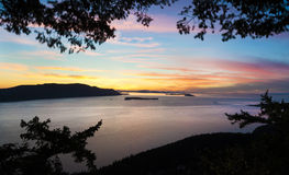 The San Juan Islands. Sunset over the San Juan Islands of Puget Sound in western Washington State, USA. Orcas Island, Clark and Barnes Island with Matia and Stock Photo