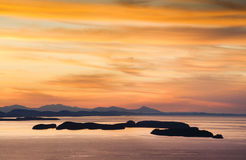 The San Juan Islands. Sunset over the San Juan Islands of Puget Sound in western Washington State, USA. Orcas Island, Clark and Barnes Island with Matia and stock photography