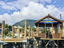 The view from the tour boat arriving at the docks of the small Mayan village San Juan La Laguna. San Juan La Laguna, Guatemala - May 20th, 2018: The view from stock photography