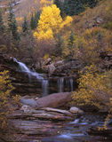 San Juan Mountains Waterfall. A small waterfall in the San Juan Mountains of southwest Colorado photographed during the autumn season royalty free stock image