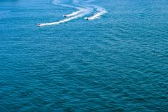 San Juan, Puerto Rico - April 02 2014: Jet Ski riders on the ocean royalty free stock photos